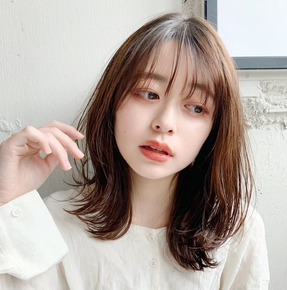tóc ngắn uốn 23